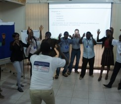 Participants in an energizer during the RBM&E Workshop