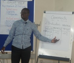 The Facilitator, Frank Shombo reacting on feedback from a session of group exercises